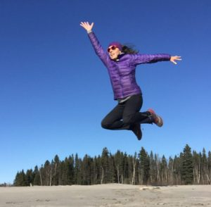 Jumping for joy next to the Churchill River